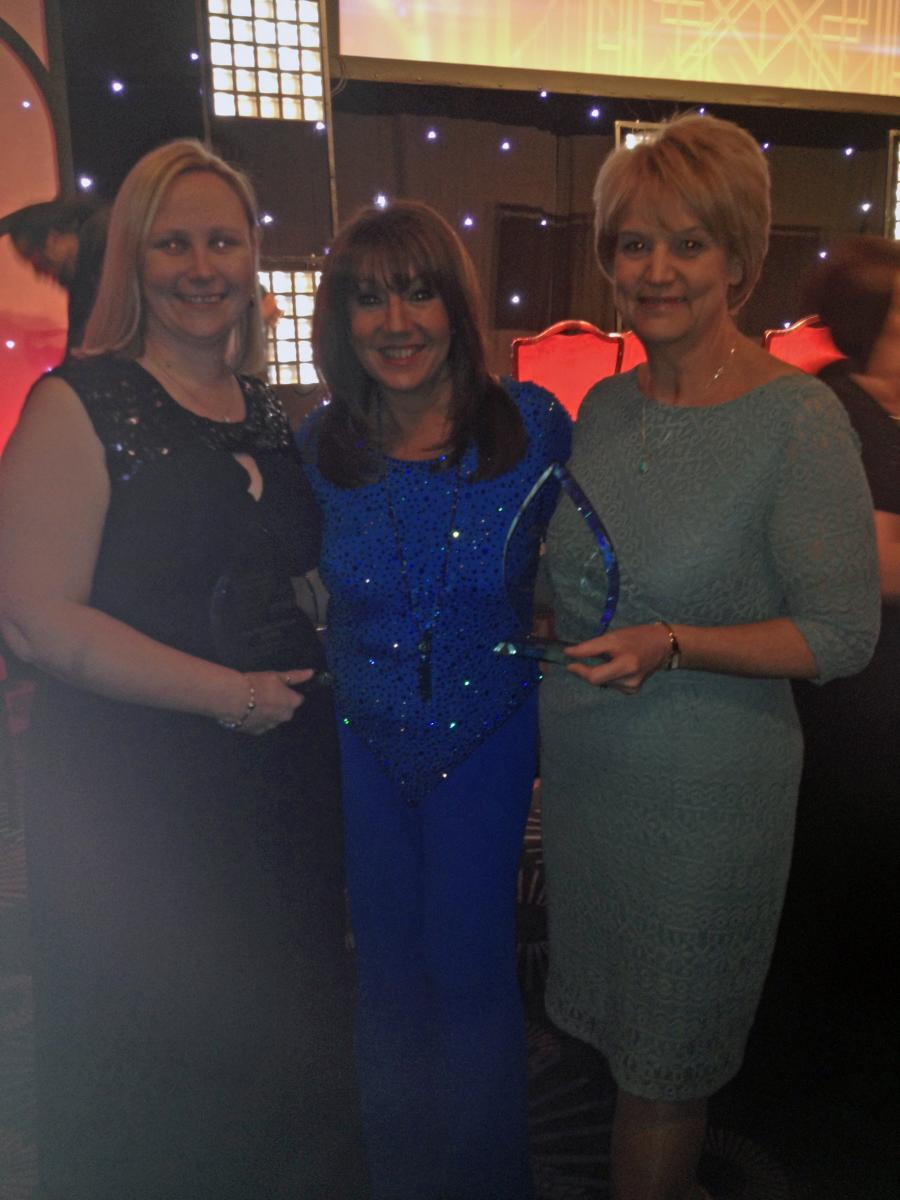Adrienne and Christine, pictured with awards host Jane McDonald