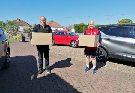 Middlesbrough FC volunteers holding treat boxes