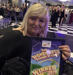 Support workOur colleague holding the South West Care Award.