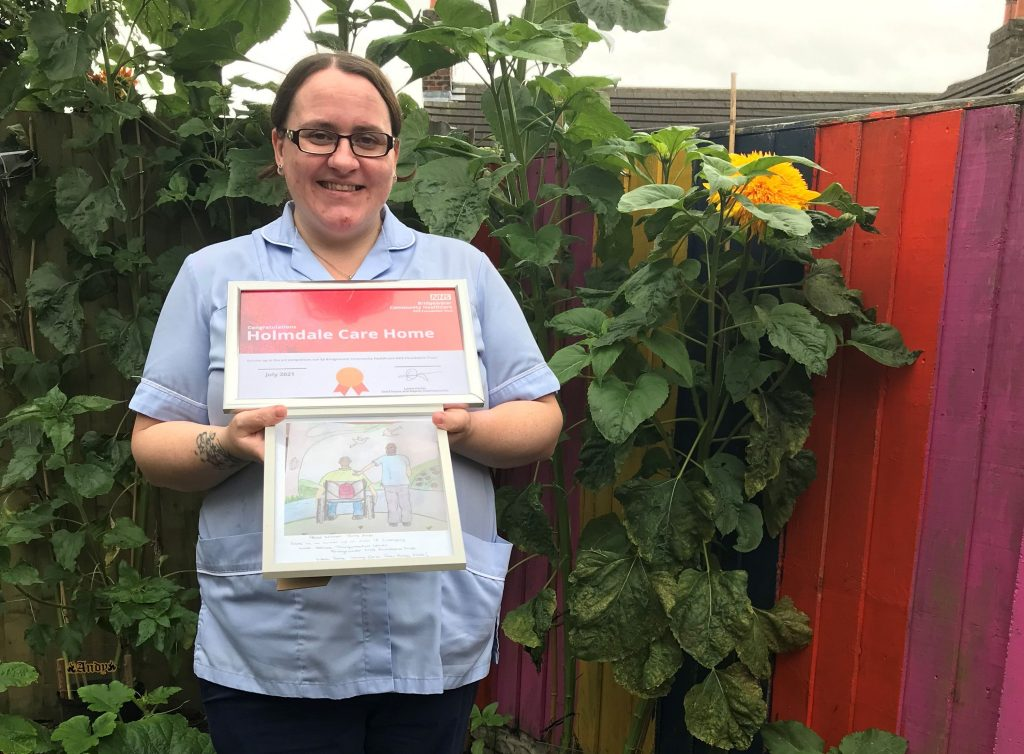 Jenny Wallace, a Support Worker at our Holmdale service in Runcorn with Arts award and artwork.